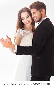 Dancing newlyweds. sweet photo. white background