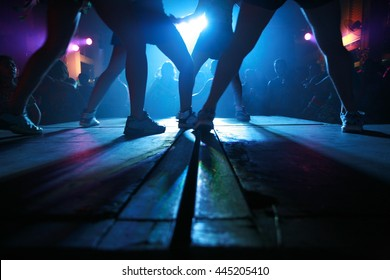 Dancing on stage.