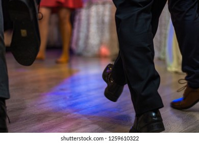 Dancing people feet on floor, unfocused