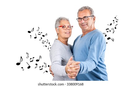 dancing Senior couple with notes, mature couple, age and people concept - happy senior couple