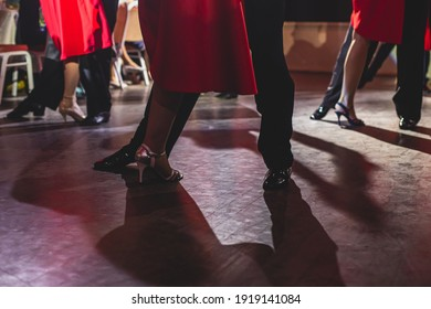 Dancing shoes of young couple, Couples dancing traditional latin argentinian dance milonga in the ballroom, tango salsa bachata kizomba lesson, dance festival, wooden floor, close up view of shoes