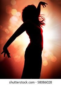 dancing silhouettes of woman in a nightclub