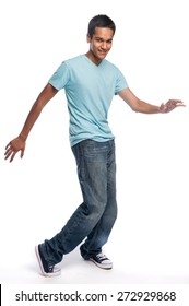 Dancing teenager on a white studio background.