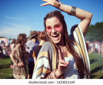 Dancing woman at the music festival