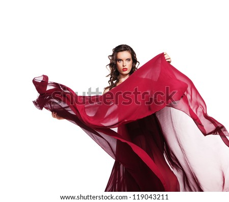 ae404505fb53 Dancing woman in red dress waving flying on wind flow with long curly hair