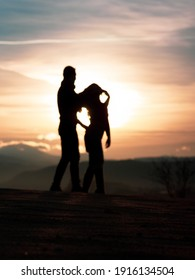 Dancing young couple silhouette during sunset in Cappadocia