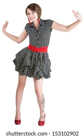 Dancing young woman with butterfly tattoo and mini skirt
