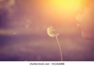 Dandelion blower woman