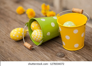Dandelion flower and easter eggs decoration on wooden table