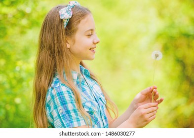 Dandelion full symbolism. Summertime fun. Folklore beliefs about dandelion. Girl rustic style making wish and blowing dandelion nature background. Why people wish on dandelions. Celebrating summer.