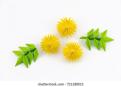 dandelion origami with green leaves on white background