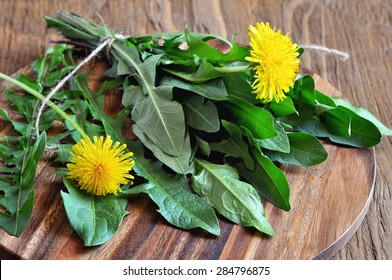 Dandelions leaves on a table