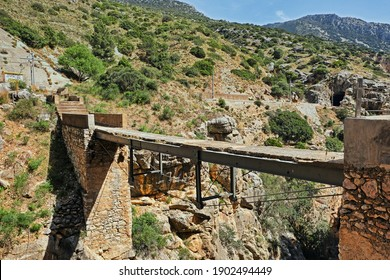 Dangeorus bridge catwalk in the Caminito del Rey gorge in Malaga (Spain)