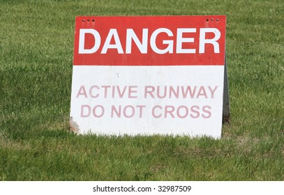 Danger active runway sign on the grass.