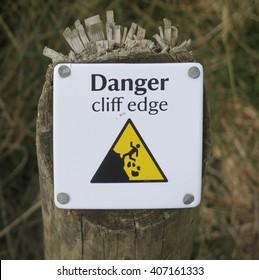 """Danger Cliff Edge"" Sign on the South West Coastal Path at Abbotsham on the North Coast of Devon, England, UK."