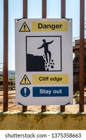 Danger Cliff Edge Stay Out warning sign on a quarry gate