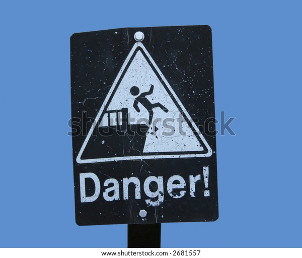 Danger cliff sign with figure falling