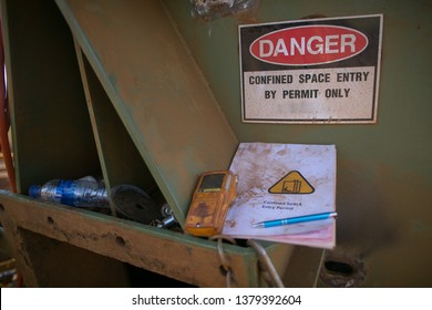 Danger confined space sign with gas detector and entry permit book at the  confined space entry door