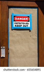 Danger Construction Area sign posted on a door