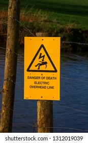 Danger of Death sign by river