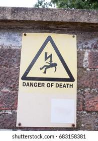 danger of death yellow sign with lightening; Essex; UK