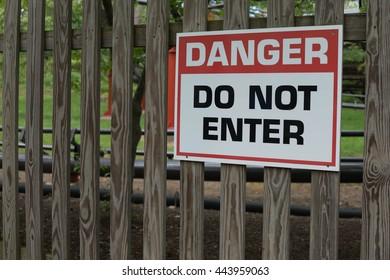 Danger Do Not Enter Sign on Wooden Fence