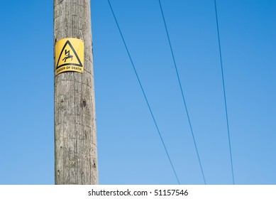 Danger of electrocution sign on electric pole