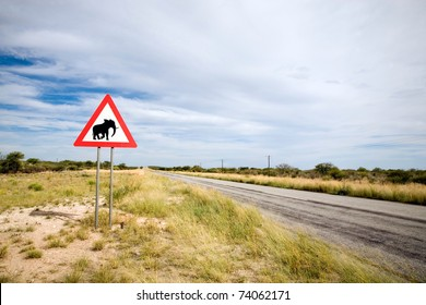 Danger Elephant Crossing Road Sign close to Country Road, Namibia, South West Africa