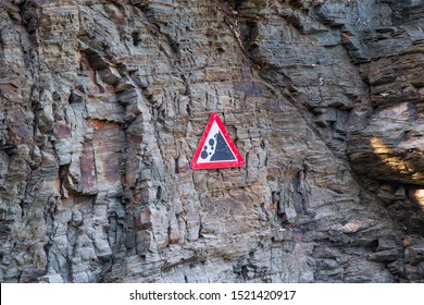 Danger Falling Rocks sign on a Cornish cliff