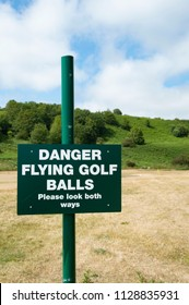 """Danger - Flying Golf Balls"" - Sign Warning Public That Venture On Road Passing Through Golf Course"
