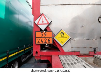 Danger good signs in a container on a truck - trailer