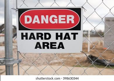 Danger Hard Hat Area Sign on Chain Link Fence