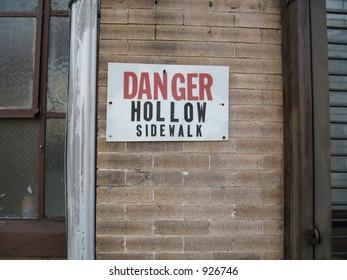 danger hollow sidewalk sign