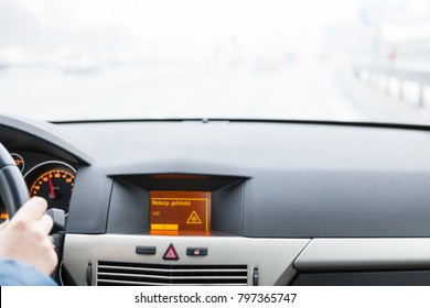 """Danger of ice"" warning on car display, car interior point of view"