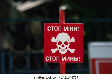 Danger, mines! A sign marking minefields in East Ukraine with Ukrainian and Russian text