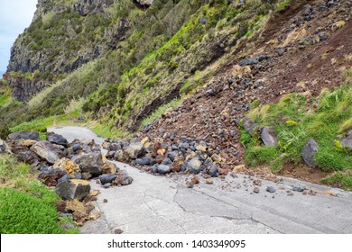 Danger mountain landslide stone slope threaten to block road for driver and resident of the city.