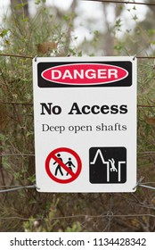 Danger No Access Deep open Shafts safety warning sign in front of closed gold mine Jupiter Diggings in Adelaide Hills South Australia
