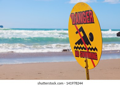 Danger - no swimming. Sign seen on the beach in New Zealand.