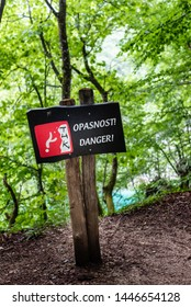 Danger, Opasnost, sign warning of falling from high cliff in the Plitvice Lakes national park in Croatia