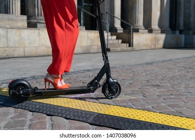 Danger points for e-scooter - cable channel on cobblestones