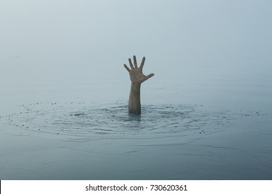 Danger, problems, risk concept. Close up of human hand drowning in the lake