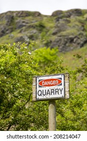 Danger quarry sign at the bottom of Berington Quarry on the Malvern Hills, Worcestershire, UK