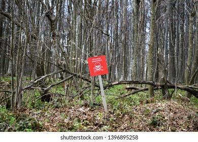 Danger sign in front of minefield - translation from Croatian: Danger mines