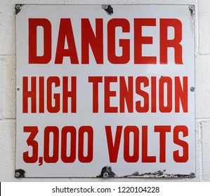 Danger Sign - High Voltage 3000 Volts on the wall of an electricity switching station.