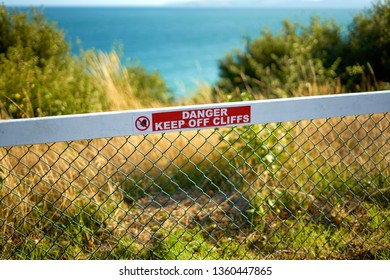 Danger Sign - Keep Off Cliffs with beautiful  sea view during summer day in popular coastal town Bournemouth, Dorset. England.