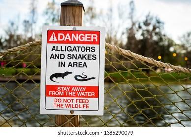 danger sign near swamp area