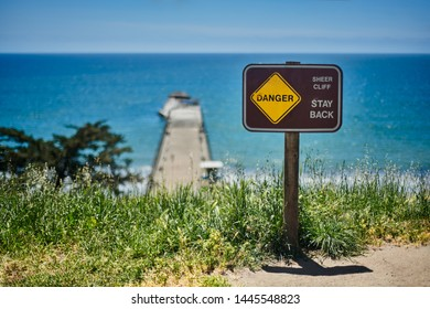 Danger Sign on cliff with ocean view