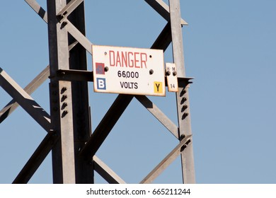 Danger sign on high voltage tower