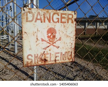 A danger sign post. A warning to observe caution in an electricity substation. Sign post to avoid electrocution.