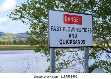 Danger sign warning of fast flowing tides and quicksands